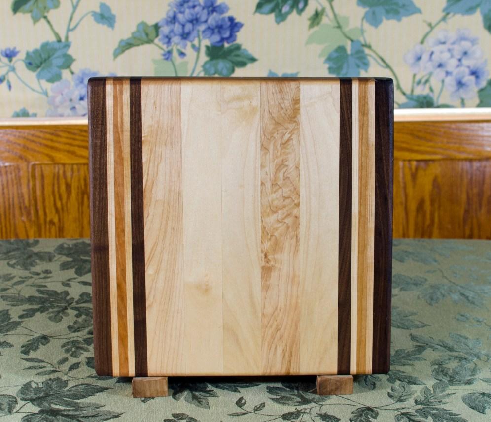"Cutting Board 17 - 116. Black Walnut, Hard Maple & Cherry. Edge Grain. 12"" x 12"" x 1-1/4""."