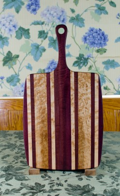 "Sous Chef 17 - 917. Purpleheart & Birdseye Maple. Large size, with the work space approximately 11"" x 15"", with the handle extending for an additional 6""."