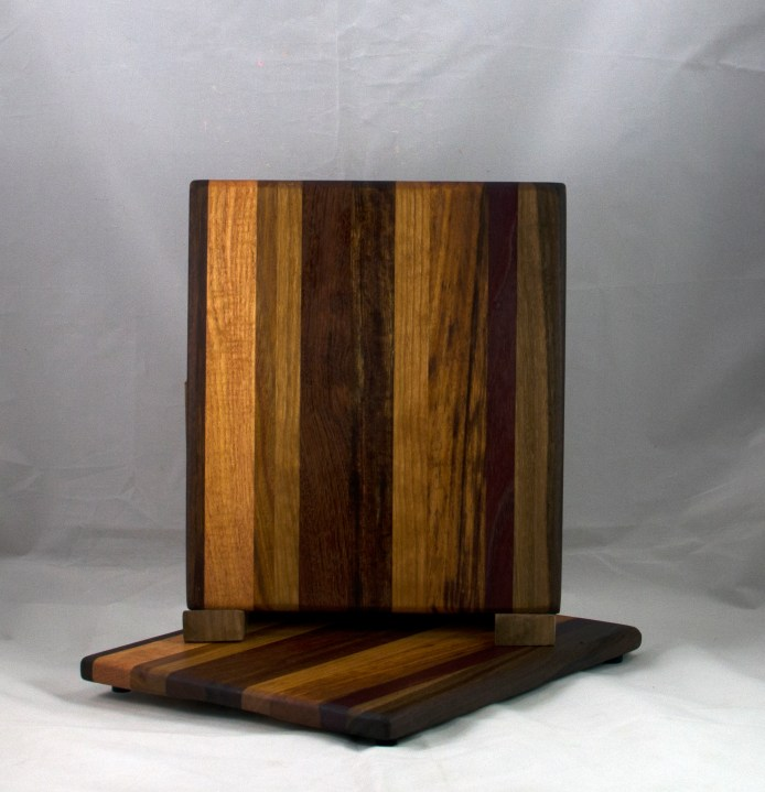 "Cheese Board 17 - 325. Black Walnut, Cherry, Jatoba, Goncalo Alves & Purpleheart. 8"" x 11"" x 5/8""."