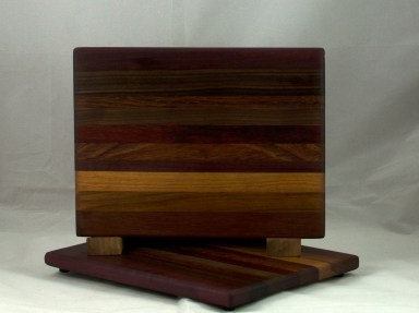 "Cheese Board 17 - 327. Black Walnut, Jatoba, Honey Locust, Canarywood, Padauk & Bubinga. 9"" x 11"" x 5/8""."