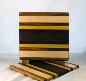 "Cheese Board 17 - 329. Canarywood, Hard Maple, Yellowheart & Caribbean Rosewood. 8"" x 11"" x 5/8""."
