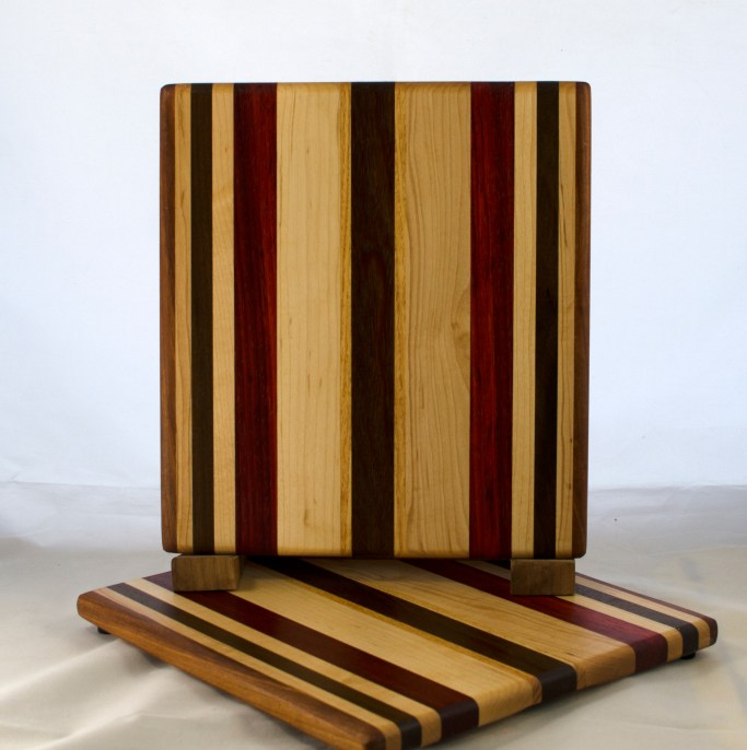 "Cheese Board 17 - 337. Canarywood, Yellowheart, Hard Maple, Padauk & Black Walnut. 8"" x 11"" x 5/8""."