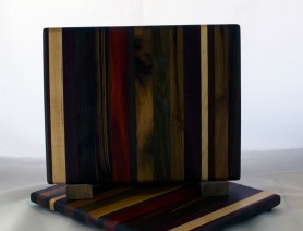 "Cheese Board 17 - 343. Black Walnut, Hard Maple, Padauk, Goncalo Alves & Purpleheart. 8"" x 11"" x 5/8""."