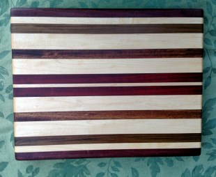 "Cutting Board 17 - 125. Edge grain. Purpleheart, Hard Maple, Jatoba and Bubinga. 12"" x 16"" x 1-1/4""."