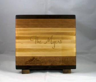 "Engraved 17 - 023. Black Walnut, Cherry & Hard Maple. Engraving styled after the ""save the date"" received for their wedding."