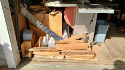 The back of the table saw has storage for wood blocks used when I get big lumber orders, and overflow of jigs & mineral oil gallon jugs. Not efficient at all!