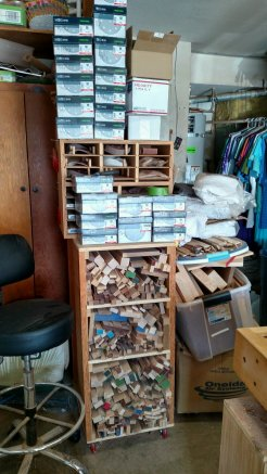 At the end of the workbench, is this rolling cabinet of cut offs. On top of the cabinet is my sanding station, with all of my sanding supplies, kept close at hand for when I'm sanding, always on top of the workbench.