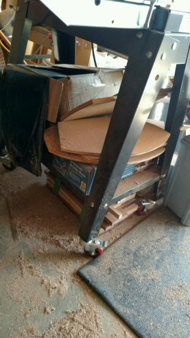 Below the drum sander, I store jigs. And dust collector bags. And, uh, a mobile tool platform kit. Not efficient at all.