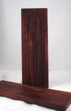 "Cribbage 17 - 02. Bubinga. Non-skid rubber feet. 5"" x 15""."