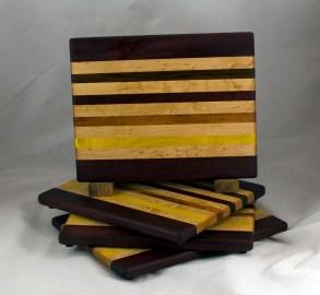 "Cheese Board 16 - 054. Purpleheart, Birds Eye Maple, Goncalo Alves, Jatoba, Bloodwood & Yellowheart. 9"" x 11"" x 3/4""."