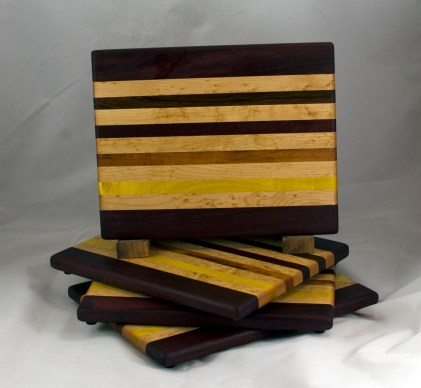 "Cheese Board 16 - 054. Purpleheart, Birds Eye Maple, Goncalo Alves, Jatoba, Bloodwood & Yellowheart. 9"" x 11"" x 3/4""."