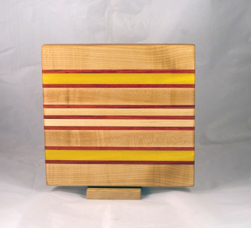 "Small Board 17 - 245. Hard Maple, Padauk & Yellowheart. 10"" x 11"" x 1""."