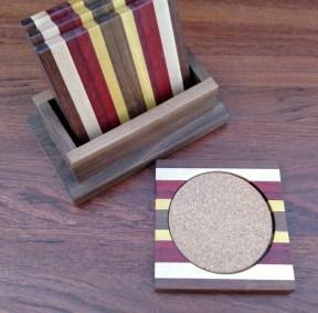 Coasters 18 - 07. Jatoba, Hard Maple, Bloodwood, Purpleheart, Yellowheart & Black Walnut. Shown with Black Walnut holder.
