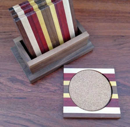 Coasters 18 - 07. Jatoba, Hard Maple, Bloodwood, Purpleheart, Yellowheart & Black Walnut. Shown with Black Walnut holder.