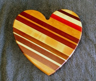 "Heart 18 - 908. Cherry, Purpleheart, Hard Maple, Jatoba & Padauk. 11"" x 11"" x 3/4""."