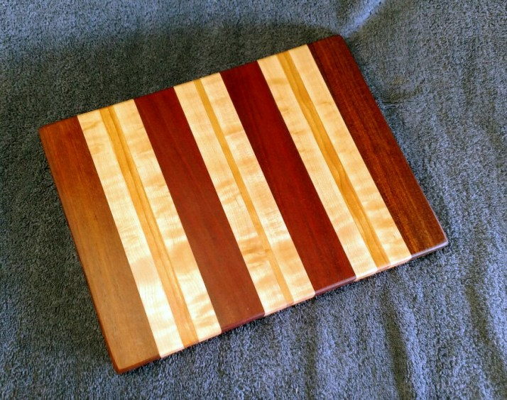 "Small Board 18 - 201. Bloodwood, Jatoba, Birds Eye Maple & Jatoba. 9"" x 12"" x 3/4""."