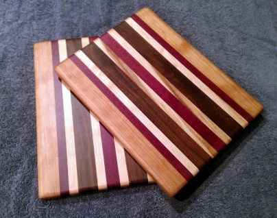 "Cheese Board 18 - 114. Cherry, Purpleheart, Black Walnut & Hard Maple. 8"" x 11"" x 5/8""."