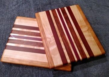 "Cheese Board 18 - 115. Cherry, Hard Maple, Bloodwood, Bubinga & Purpleheart. 9"" x 11"" x 5/8""."