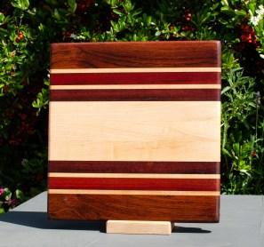 "Small Board 18 - 206. Jatoba, Hard Maple, Bloodwood & Bubinga. 12"" x 12"" x 1"". Commissioned piece."
