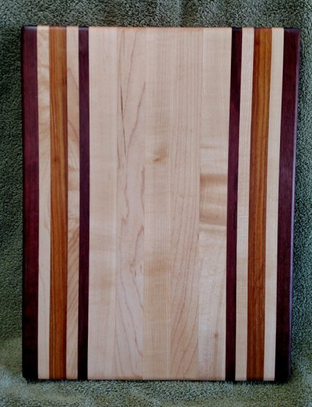 "Cutting Board 18 - 319. Purpleheart, Hard Maple & Canarywood. 12"" x 16"" x 1-1/8""."