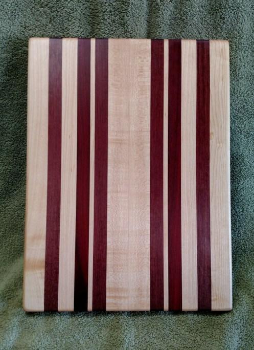 "Cutting Board 18 - 323. Hard Maple, Bloodwood & Purpleheart. 12"" x 16"" x 1-1/8""."