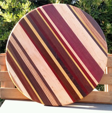 "Lazy Susan 18 - 15. Woods include Oak, Black Walnut, Hard Maple, Yellowheart, Purpleheart and Padauk. 18"" diameter."