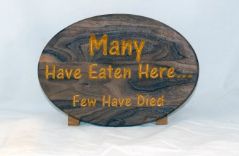CNC Sign 18 - 114 Many Have Eaten. Black Walnut with Gold lettering. Commissioned piece.