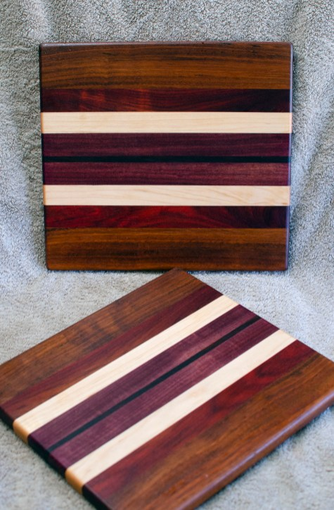 "Cheese Board 18 - 127. Jatoba, Bubinga, Hard Maple, Purpleheart & Caribbean Rosewood. 9"" x 11"" x 5/8""."