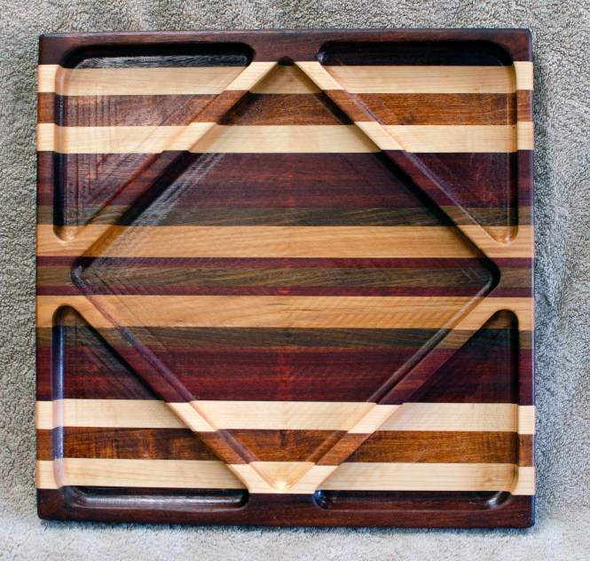 "Cheese & Cracker Serv-er 18 - 203. Jatoba, Hard Maple, Jatoba, Mesquite, Bloodwood, Cherry & Black Walnut. 14"" square x 1-1/8"" thick."