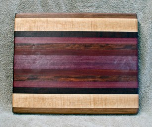 "Cutting Board 18 - 324. Black Walnut, Hard Maple, Jarrah, Purpleheart, Bubinga & Bloodwood. 12"" x 16"" x 1-1/4"". Edge Grain."