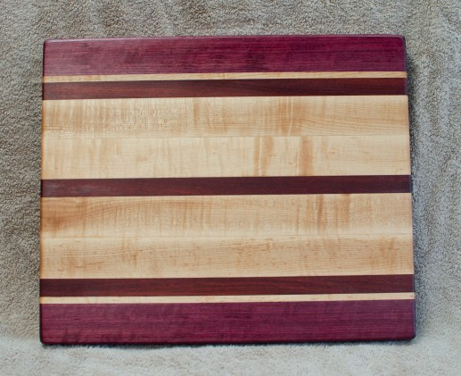 "Cutting Board 18 - 327. Purpleheart, Bloodwood & Hard Maple. 12"" x 16"" x 1-1/4"". Edge Grain."