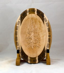 Cribbage 18 - 25. Cribbage top is a fir tree, 3D carved. Birds Eye Maple.