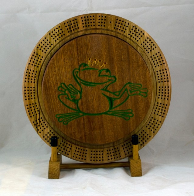 Cribbage 18 - 37. Sapele top for a 4 track board. Crown prince frog, painted gold & green.