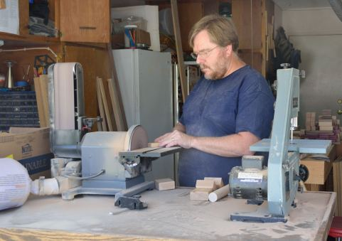 The benchtop sander makes quick work of corners and rough edges.