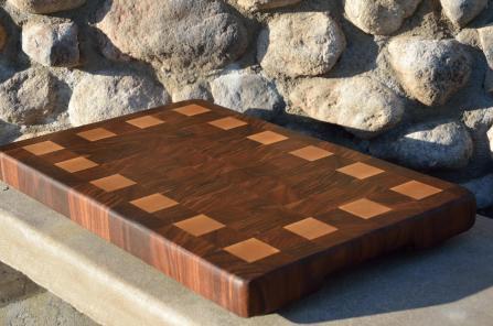 # 75 Cutting Board, $150. Black Walnut and Hard Maple.