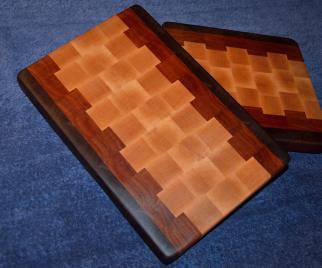 # 24 Cutting Board, $50. End grain. Walnut, cherry and maple.