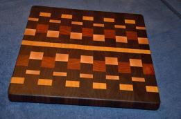 "Cutting Board # 15 - 007. Black Walnut, Yellowheart, Hard Maple and Cherry end grain. 16"" x 16"" x 1-1/2""."