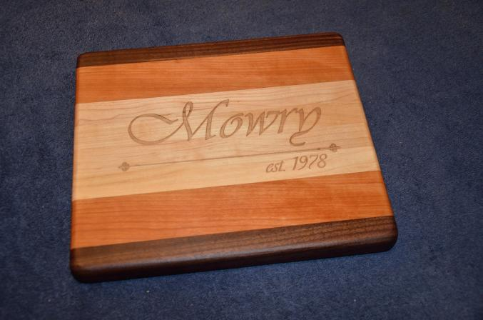 "Engraved # 15 - 04. 8"" x 12"" x 1-1/8"". Black Walnut, Cherry and Hard Maple."