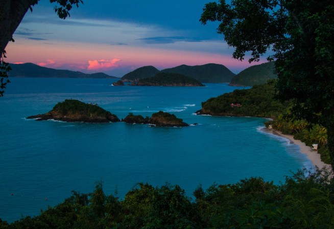 Overlook of the park's Trunk Bay at sunset. Trunk Bay is considered one of the most beautiful beaches in the world and features a 225-yard long underwater snorkeling trail. Photo by Kerry Childers. Posted on Tumblr by the US Department of the Interior, 2/12/15.