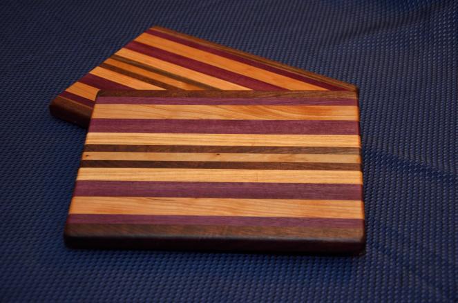 "Cheese Board # 15 - 019. Black Walnut, Purpleheart, Honey Locust Edge Grain. 9"" x 11"" x 1""."