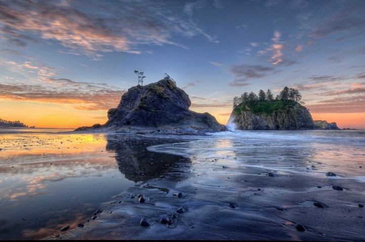 Olympic National Park​ in Washington. About 100 miles from Seattle, Olympic is a place of beauty and variety. Untamed rivers flow from glacier-capped peaks through valleys of old-growth forests, waves crash against a shoreline rich with life, and only trails traverse the vast interior of this internationally recognized wilderness. Pictured here is sunrise from the park's Second Beach. Photo by Glenn Nelson. Posted on Tumblr by the US Department of the Interior, 6/1/15.