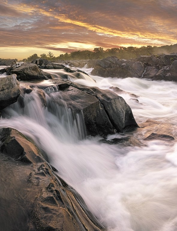 Just before it flows past Washington, DC, the Potomac River builds up speed and force as it falls over a series of steep, jagged rocks and rushes through a narrow gorge. Great Falls Park offers tremendous views of this powerful, natural spectacle. Hikers enjoy several trails along the river and sometimes gasp at expert kayakers who brave the falls. This sunrise picture was taken on the Virginia side of the river. Photo by Yin Lau. Posted on Tumblr by the US Department of the Interior, 9/14/15.