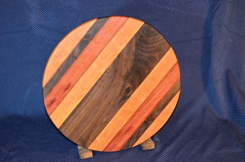 """Lazy Suan 15 - 033. Cherry, Black Walnut, Jarrah ... and the center piece of Black Walnut is quilted. 17"""" diameter x 3/4"""""""