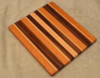 "Cheese Board # 15 - 067. Cherry, Hard Maple & Black Walnut. 9"" x 11"" x 3/4""."