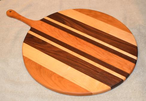 "Pizza Server # 15 - 05. Cherry, Hard Maple & Black Walnut. 17"" x 3/4"" with 7"" handle."