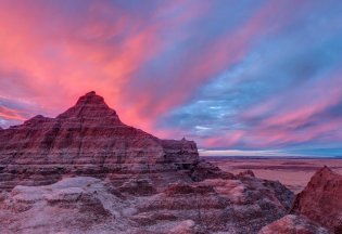 Only a spectacular sunrise can hope to match the natural artistry of Badlands National Park in South Dakota. The rugged beauty of this unique landscape draws visitors from around the world to enjoy the sights and explore one of the world's richest fossil beds. Photo by Jerry Smith. Tweeted by the US Department of the Interior, 4/1/16.