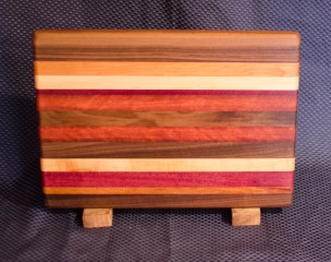 "Cheese Board 16 - 010. Edge Grain. Black Walnut, Cherry, Hard Maple, Purpleheart & Jarrah. 9"" x 13"" x 1""."