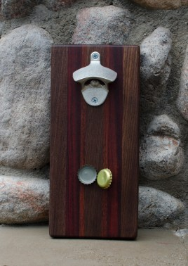 "Magic Bottle Opener 16 - 01. Black Walnut, Bloodwood & Jarrah. Approximately 5"" x 10"" x 3/4"". Claimed by Mrs M."