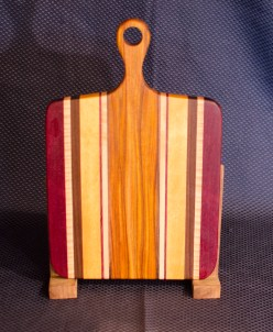 """Sous Chef 16 - 009. Purpleheart, Quilted Hard Maple, Black Walnut, Yellowheart & Canarywood. 9"""" x 12"""" work surface & 4"""" handle."""