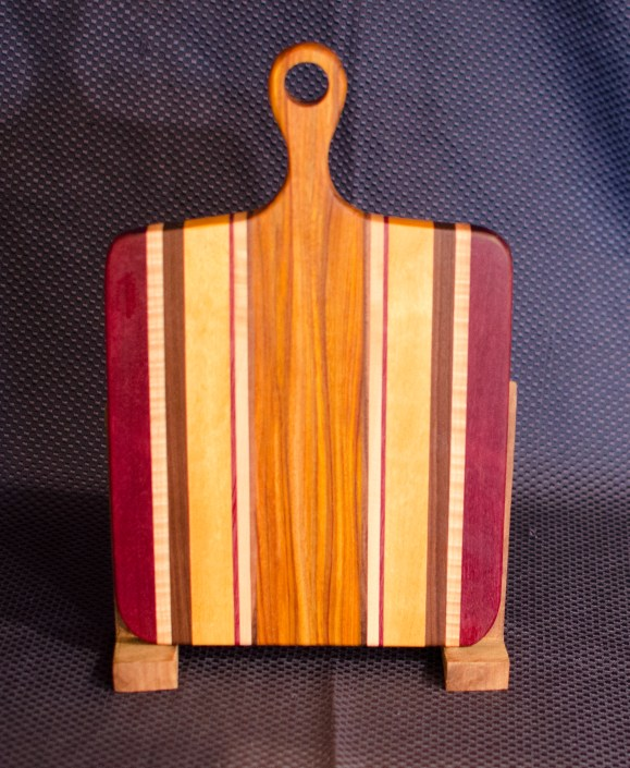 "Sous Chef 16 - 009. Purpleheart, Quilted Hard Maple, Black Walnut, Yellowheart & Canarywood. 9"" x 12"" work surface & 4"" handle."
